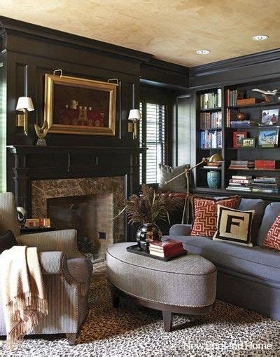 cozy living room dark walls built  shelving house
