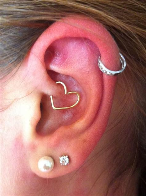 tattooed heart piercing 183 best images about tattoo piercing on pinterest