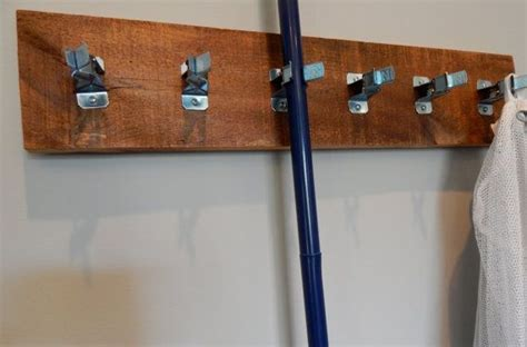 Rack To Hang Brooms And Mops by Hanging Utility Rack Broom And Mop Holder Laundry