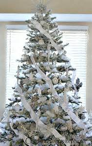 tree silver white: silver and white decorated christmas tree with faux snow one more time