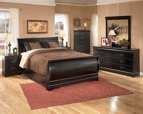 black sleigh bedroom set huey vineyard 4 piece sleigh bedroom set in black