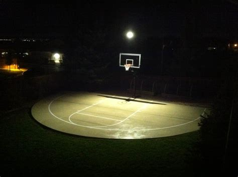 basketball courts with lights during the night time the lights turn on for homeowners