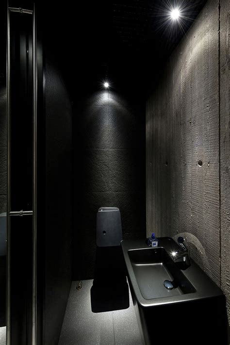 dark bathroom house in the woods of kaunas lithuania
