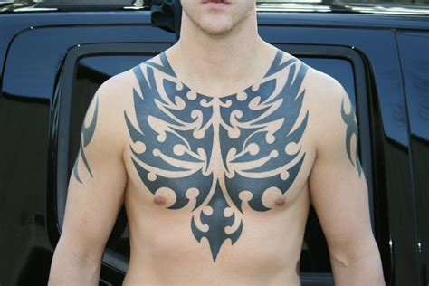 tribal chest tattoos for men designs black ink tribal on chest