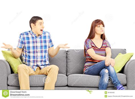 couch people young couple sitting on a sofa during an argument stock