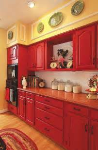 Red Kitchen Paint Ideas red cabinets paired with pale yellow walls and white subway tile