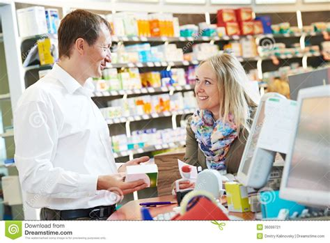 pharmacy chemist workers in drugstore stock image image