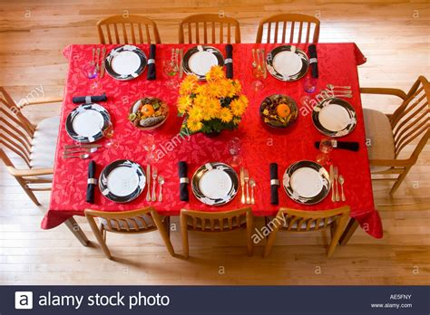 dining room place settings aerial view of dining room table place settings with red
