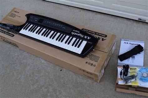 Keyboard Roland Ax Synth roland ax synth synthesizer keyboard keytar black sparkle reverb