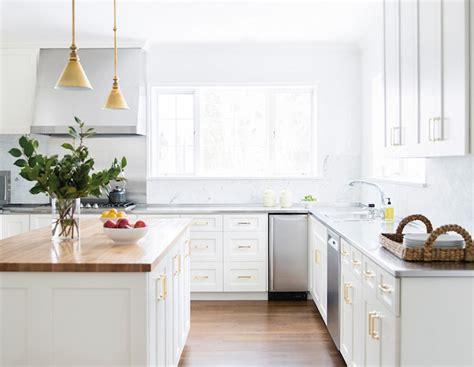 white kitchen cabinets with brass hardware