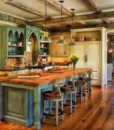 Pine floors match the butcher block countertop of the kitchen island
