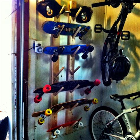 diy skateboard rack 2x4 s and a cut up dowel rod awesome