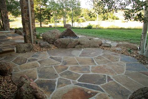 backyard flagstone luxescapes landscape design and installation contractor greater denver area fire