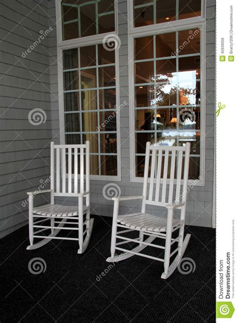 Two white adirondack rocking chairs on front porch stock photo image 45939056