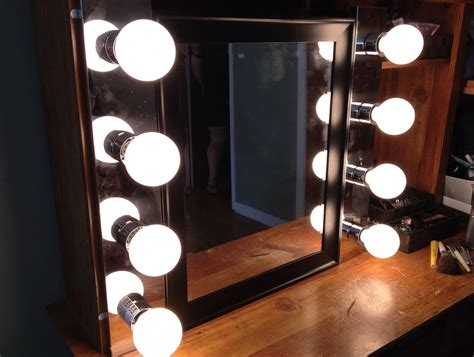 Mirror With Light Bulbs Around It by Mirror With Light Bulbs Around Designs