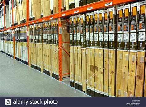 a row of many wooden doors for sale at home depot in