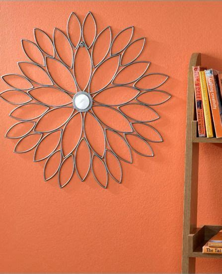 Orange Wall Decor by Orange Walls And Striking Metal Wall Home Land