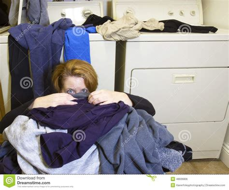Buried In Laundry Stock Photo Image 48936806 Covered Laundry