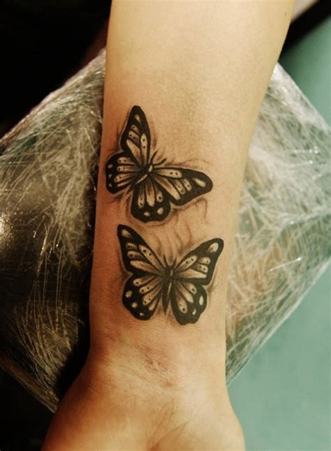 wrist tattoo information tribal butterfly on wrist