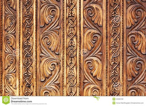 pattern of wood frame carved old hand carved wooden pattern on a monastery door stock