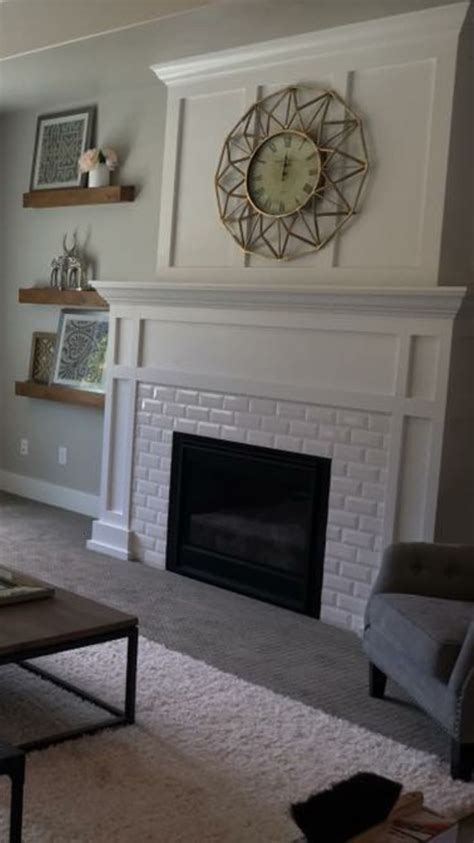 25 best ideas about subway tile fireplace on