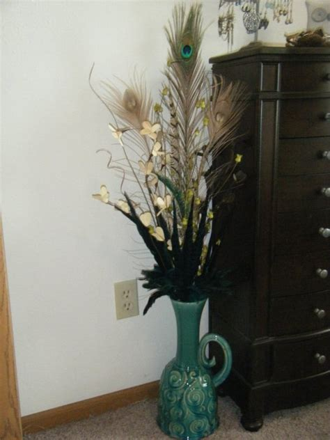 feathers and dried flowers in vase stuff i made