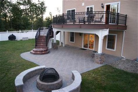 Tudor Floor Plans Second Story Curved Deck With Stairs Leading To Paver Patio And Fire Pit Below Picmia