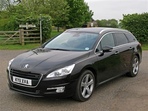 peugeot cars 2011 peugeot 508 sw 2011 photos parkers