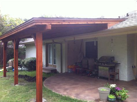 Clean, Shingled Patio Cover Extends Over Patio and Yard