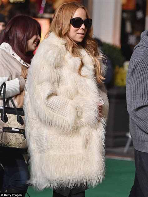 Careys Fur Coat Is Lost In The Mail by Carey Cuts A Stylish Figure In Glamorous Fur Coat