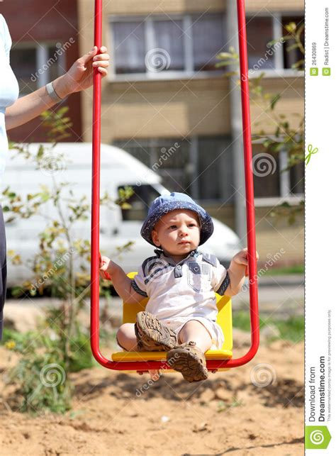 swinging a baby baby swinging on swing royalty free stock images image