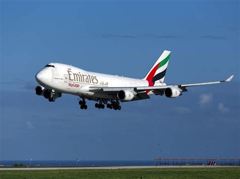 emirates member emirates confirms crew member fell from plane courtroom mail