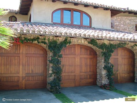 spanish style garage access showroom garage door repair and install