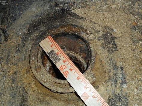 Oversize cast iron offset flange in a concrete floor