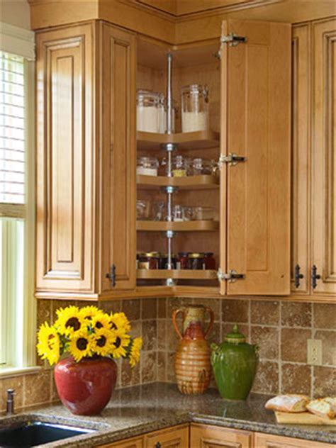 adding a lazy susan in a corner cabinet increase storage in your kitchen cabinets by installing a