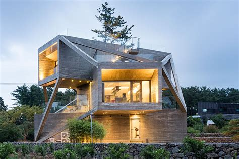 anything but the house this wacky concrete house is made of angled volumes curbed