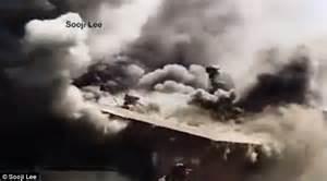 anaheim firefighter falls through roof california firefighter falls through roof at burning