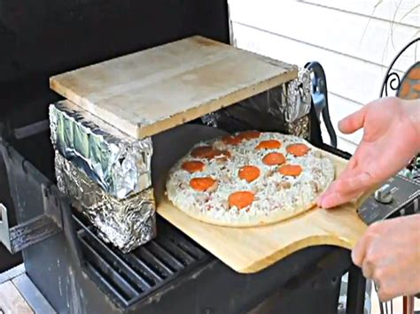homemade brick oven pizza on a gas grill video by