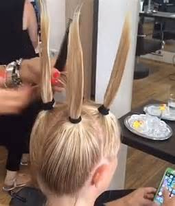 how to do layers the ponytail method on curly american hair hairdresser at m m friseure salon pulls woman s locks into four bunches to cut it daily mail