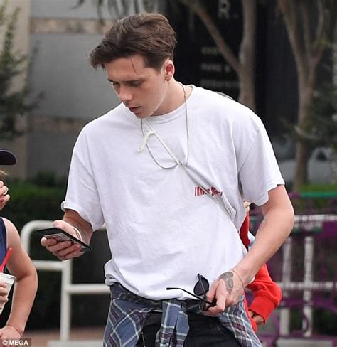 brooklyn beckham displays new hand tattoo with dad david