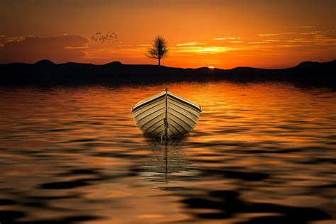 row boat on water brown row boat on body of water painting 183 free stock photo