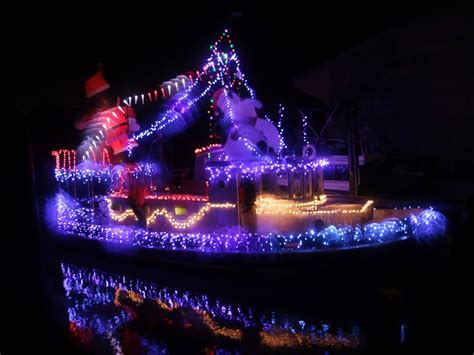 boat lights on the james james river parade of lights county of henrico virginia