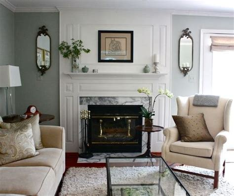 Cream Sofa Neutral Gray Walls And A White Fireplace