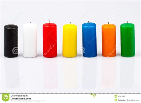 colored candles seven colored candles on a white background stock photo