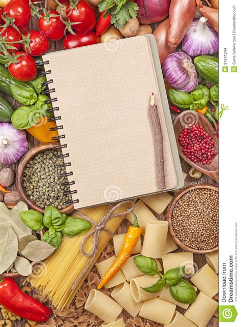 assortment of fresh vegetables and blank recipe book stock