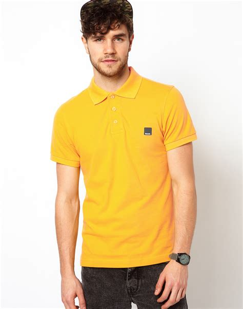 bench t shirts for men bench polo shirt in yellow for men lyst