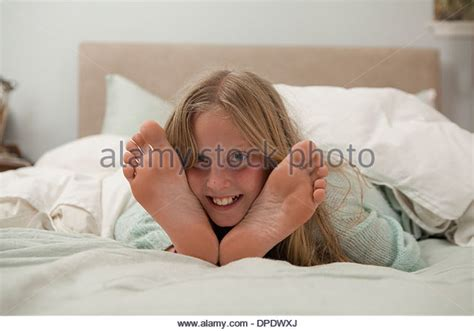 girl in bed feet in bed stock photos feet in bed stock images alamy