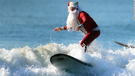 santa on surfboard photos santa sightings around the world