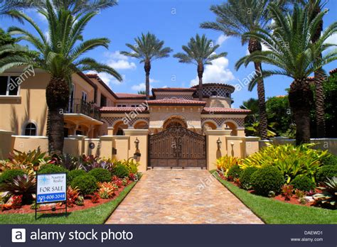 houses to buy in miami miami beach florida house home mansion sale sign real estate gate stock photo royalty