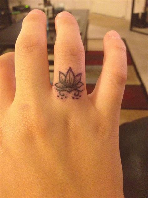 9 lotus flower finger tattoos